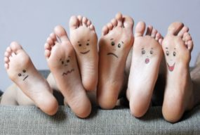 Small faces painted on the soles by Timof   www.shutterstock.com