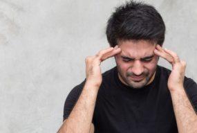 Man Suffering From Headache By 9nong   www.shutterstock.com